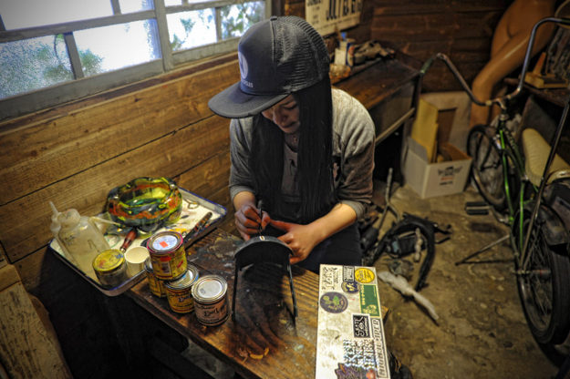Pinstripe artist Lou at Heiwa, the Japanese custom motorcycle workshop.