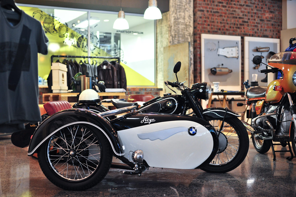 Itu0027s On Display In A Cosy Corner Of The Shop That Includes Couches, Photos,  Books, A R90 S And A Stoye Sidecar ...