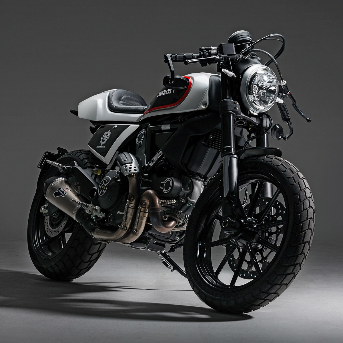 skunk machine: a cafe twist for the ducati scrambler | bike exif